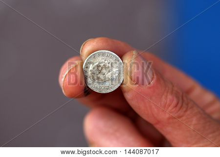picture of a Fingers hold old coin from serbia