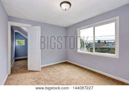 Empty Room Interior With Lavender Walls And Beige Carpet.