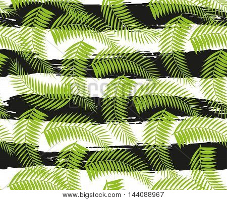 Beautiful seamless tropical jungle floral pattern background with palm leaves. Vector illustration.