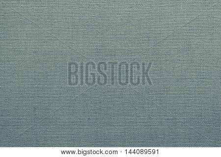 surface of fluted fabric or textile material for the textured wallpaper and for a background of monochrome green color