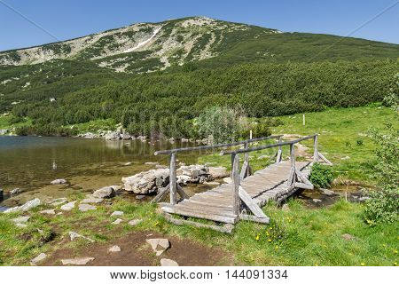 wooden bridge over river in Pirin Mountain near Bezbog lake, Bulgaria
