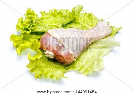 Raw chicken leg isolated on a white background