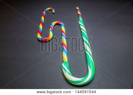 Mint Hard Candy Cane Striped In Christmas Colours On A Black Background