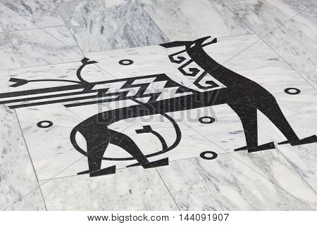 Norwegian sign symbol with winged dragon. Black marble stone. Horizontal