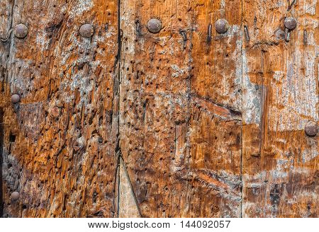 Weathered Wooden Panel Background With A Metallic Rusty Screws.