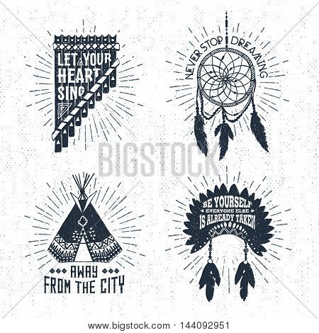 Hand drawn tribal labels set with pan flute dream catcher teepee and headdress vector illustrations and inspirational lettering.