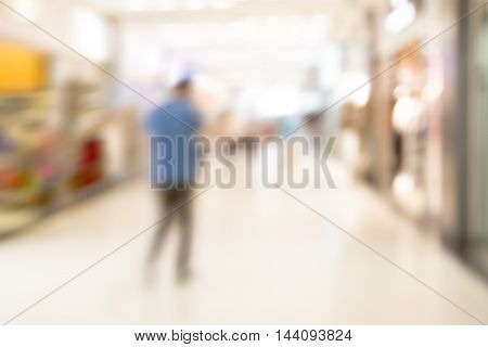 abstract blurred background of people in shop sale concept