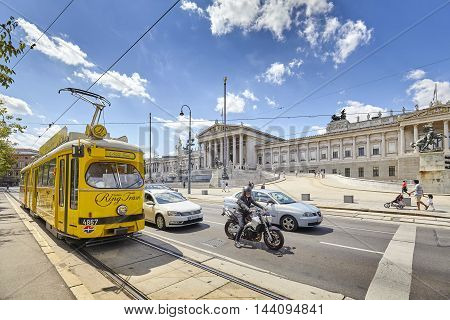 Vienna Austria - August 14 2016: Tram in front of Austrian Parliament building. Vienna Tram network is one of the largest in the world.
