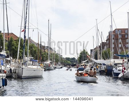 COPENHAGEN, DENMARK - JULY 23: People spending their spare time in a canal in Copenhagen at July 23, 2016