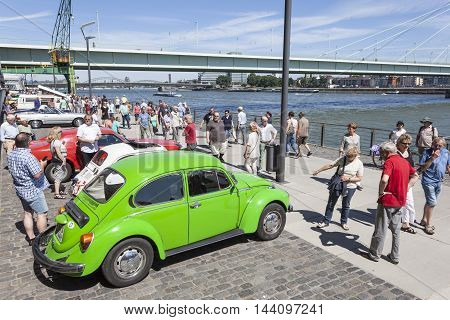 COLOGNE GERMANY - AUG 7 2016: Green Volkswagen Beetle at an historic cars exhibition in the city of Cologne Germany