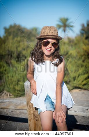 Young girl in sunglasses on a background of nature