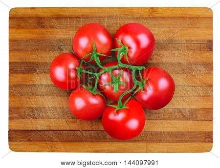 top view of a bunch of fresh tomatoes on a wooden cutting board