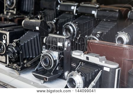 COLOGNE GERMANY - AUG 7 2016: Vintage black and white film cameras for sale at a shop in Cologne Germany
