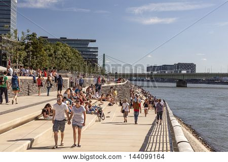 COLOGNE GERMANY - AUG 7 2016: Waterfront promenade at the Rhine river bank in the city of Cologne Germany