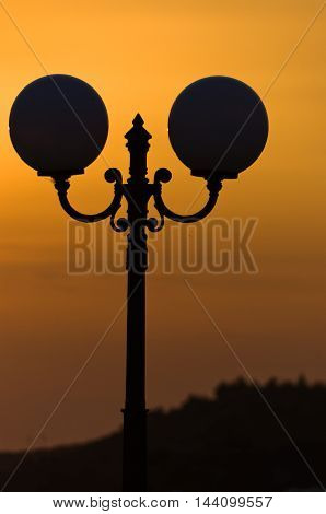 Silhouette of a lantern at sunset in Sithonia, Greece