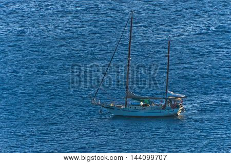 Sailboat in a small bay on a windy day at south Sithonia in Greece