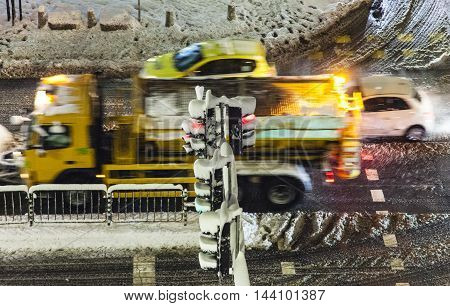 Snowy cross section at sity boulevard in Sofia, Bulgaria during a cold winter night. cars blured by motion, long exposure,