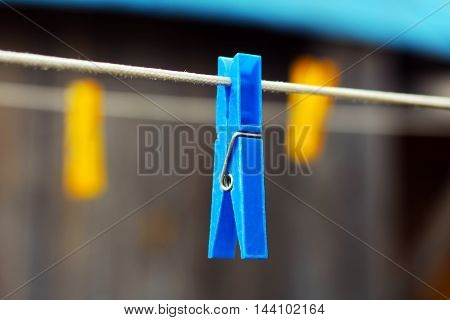 clothes pin color blue and yellow plastic