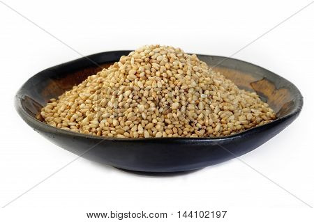roasted sesame grain seeds at on background
