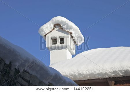 little chimney in winter covered with snow