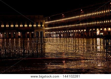 evening rain in autumn Venice with reflections