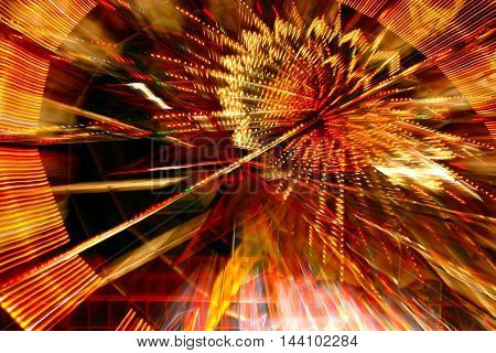 Ferris wheel with blurred lights abstract in red
