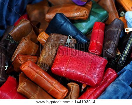 Leather handbag or wallet pile for woman
