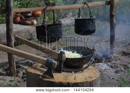Cooking on an open fire in a beautiful pot