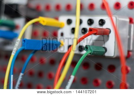 Close up of a control circuit with colored cables
