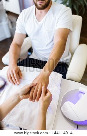 Young Man Doing Manicure In Salon. Beauty Concept.
