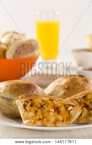 Empada Brazilian Snack. Pie With Palm On White Plate On Wooden Background