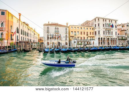 Venice, Italy - May 18, 2016: View on Grand canal with motor boat in the morning in Venice