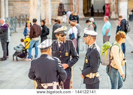 Venice, Italy - May 18, 2016: Three policemen in uniform keep safety on San Marco square in Venice