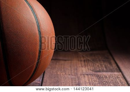 Image of a basketball sitting on the court