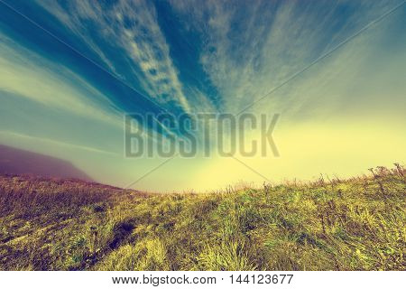 Amazing cloudscape above the mountain meadow. Caucasus. Russia.