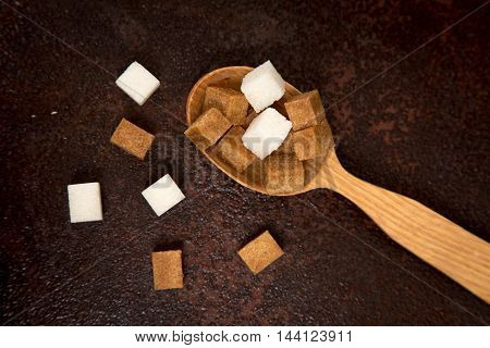 Brown And White Sugar Cubes On The Wooden Spoon