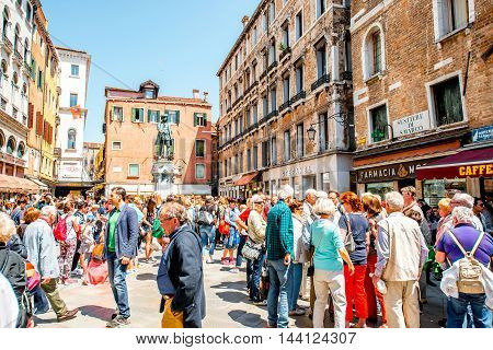 Venice, Italy - May 18, 2016: Daniele square crowded with tourists in Venice. Venice is a very popular tourist destination