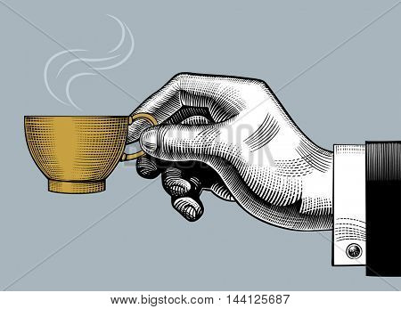 Hand with a coffee cup. Vintage stylized drawing