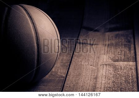 Toned image of a basketball on the court