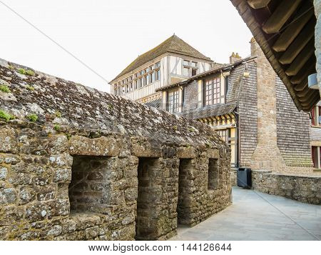 Medieval houses at the street of Mont Saint-Michel - tidal island, medieval town and abbey. France