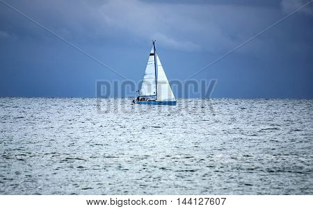 Lonely yacht before the storm in the sea