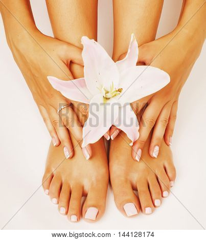 manicure pedicure with flower lily close up isolated on white perfect shape hands feet, spa people concept