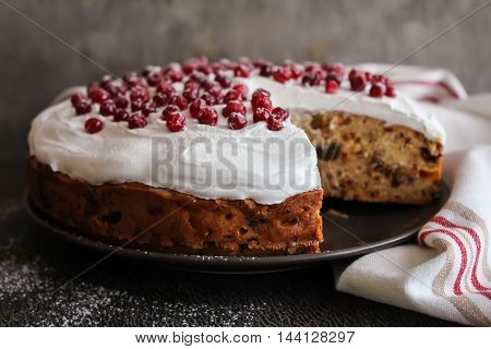 Fruit christmas cake with meringue and fresh berry, selective focus