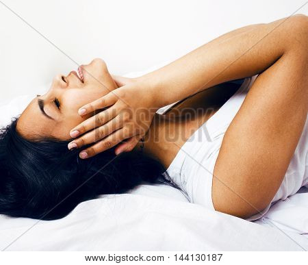 pretty brunette woman in bed, cant sleep, headache