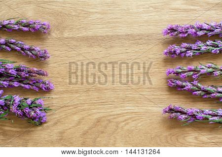 Violet Lavender Flowers On Brown Wood Background