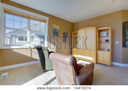 Tv Room With Two Chairs And Tv Stand
