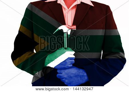 business man hold hammer with his hand on south africa flag filter abstract