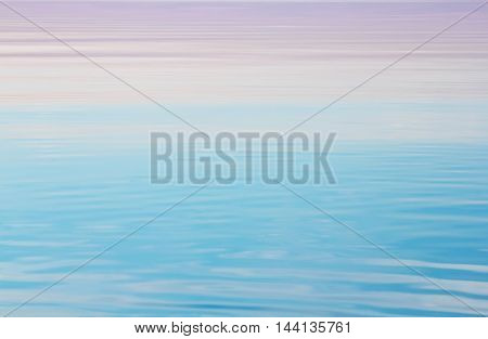 Lake tranquil pink blue water waves background