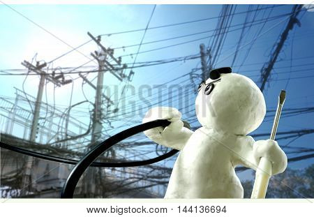 Electrician Man action Repair Sculpture cartoon in hand-held high-voltage lines and the repairman screwdriver Clay Floating Sculpture Acting Design background landscape is sky and cloud have electric pole blur