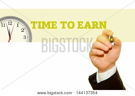 Businessman hand writing TIME TO EARN message on a transparent wipe board.